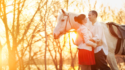Romantic retro dating. White horse on the background.