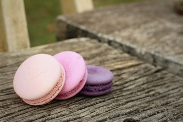 Macaroons on a wood background at the park.