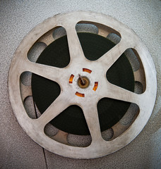 Movie reels part with filmstrip on 16 mm film projector detail