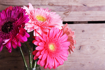 Beautiful bright gerbera flowers on wooden background
