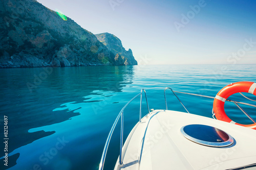 Leinwanddruck Bild Private boat near mountains. Luxury Lifestyle. Traveling yacht