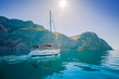 Yacht sailing along the shore the sea in calm weather. - 82125466