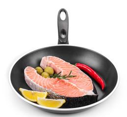 Fresh salmon steak on pan.