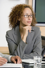 African businesswoman looking to side