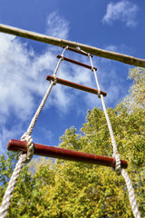 Low angle view of a rope ladder suspended from a pole