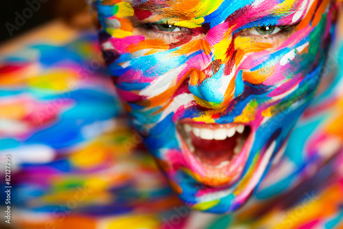 Leinwanddruck Bild Portrait of the bright beautiful girl with art colorful make-up