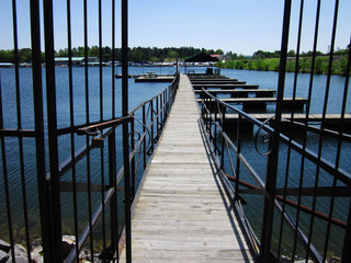Wrought Iron Gate Leading to Wooden Dock