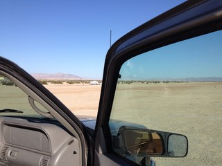 looking out from the truck to the desert
