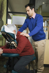 Pacific Islander massage therapist massaging client