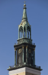 Ornate clock tower and blue sky, Berlin, Germany