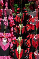 typical dot-patterned flamenco dresses on sale in a street marke