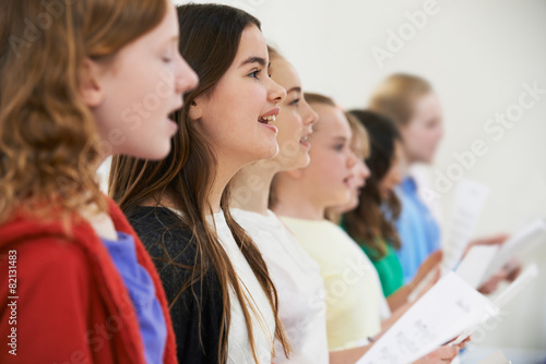 Group Of School Children Singing In Choir Together - 82131483