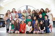 Leinwanddruck Bild - Large Group Of Children With Teacher Enjoying Drama Workshop Tog