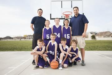 Caucasian basketball team smiling court