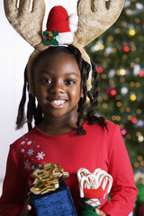 African girl holding Christmas gifts
