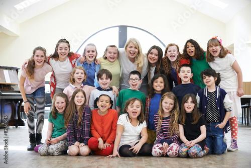Large Group Of Children With Teacher Enjoying Drama Workshop Tog - 82131843