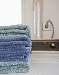 Folded Towels on a Dryer