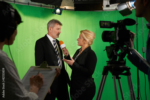Female Presenter Interviewing  In Television Studio With Crew In - 82133839