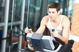 man doing cardio training on machine