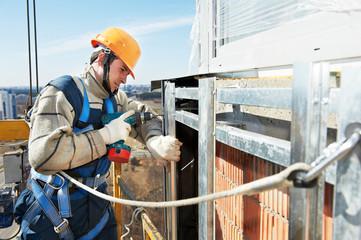 Worker builder at facade installation work