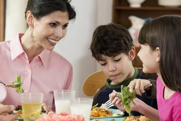 Hispanic family eating dinner together