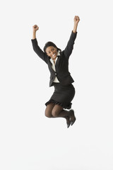 African businesswoman jumping and cheering