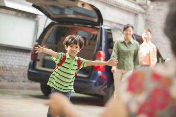 Chinese boy running to grandmother