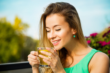 Happy Woman Drinking Green Tea Outdoors