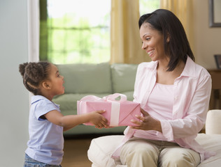Mixed Race girl giving gift to mother