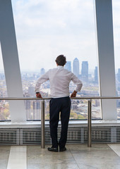 LONDON, UK - APRIL 22, 2015: Businessman looking at London