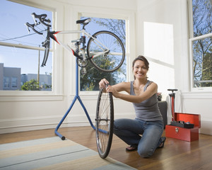 Pacific Islander woman assembling bicycle