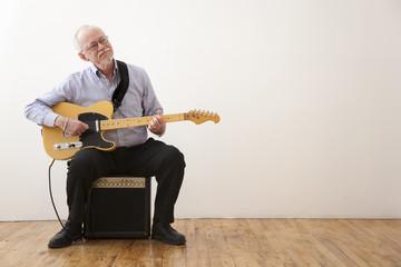 Caucasian man playing electric guitar