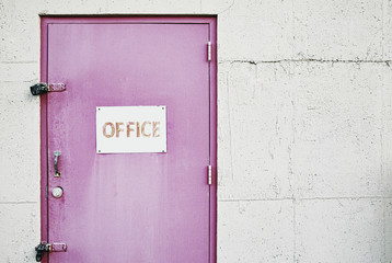 Office sign on locked door