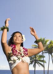 Pacific Islander woman in lei dancing