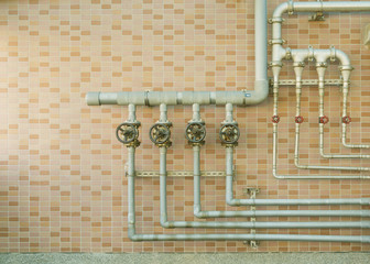 Water pipes on brick wall