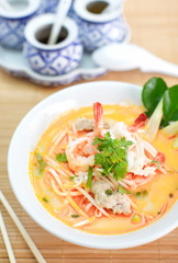 Spicy seafood noodle soup with coconut milk