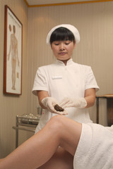 Chinese nurse using traditional medicine