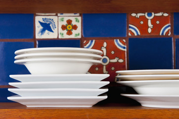 Dishes in Front of Colorful Tile