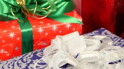 Lot of boxes, gifts tied with ribbons and bows isolated on white
