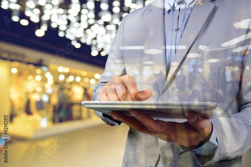 Business Man using Mobile Digital Tablet in the Shopping Mall. S - 82142811