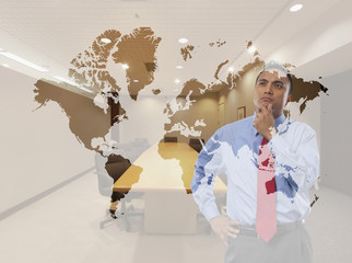 Mixed race businessman examining world map