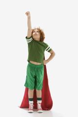 Mixed Race boy wearing towel as cape