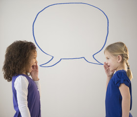 Girls whispering with empty speech bubble
