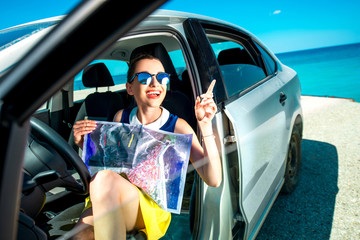 Young traveler with map sitting in the car