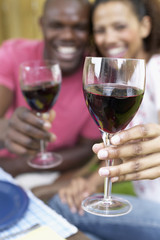 African couple toasting with wine