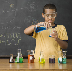 Mixed Race boy in science class