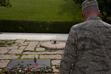 unknown soldier in front of John F. Kennedy memorial at Arlingto