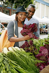 Black couple shopping at outdoor market