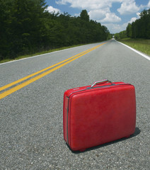 Red Suitcase Abandoned in Road