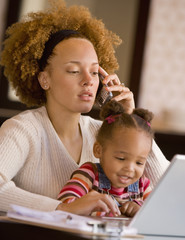 African mother working at home